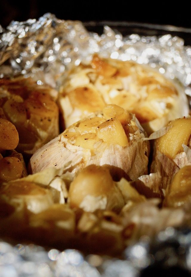 a few heads of roasted garlic in foil