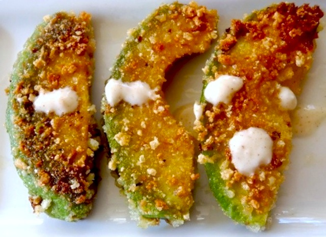 Three Avocado Fries with Agave-Chipotle Yogurt Dip on a white plate
