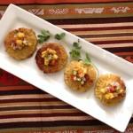 four plantain empenadas with mango salsa reicpe on a white rectangular dish