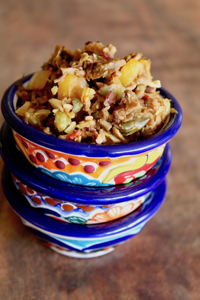 3 stacked colorful bowls with picadillo
