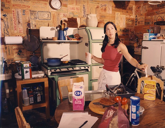 Valentina in her antique filled kitchen