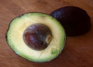 avocado half with pit