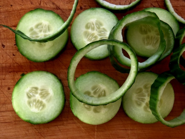 Cucumber slices with skins removed in circles