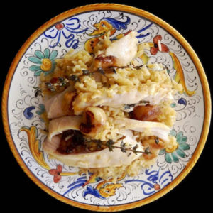 Roasted Garlic Chicken over Brown Basmati Rice on an Italian yellow and blue painted plate