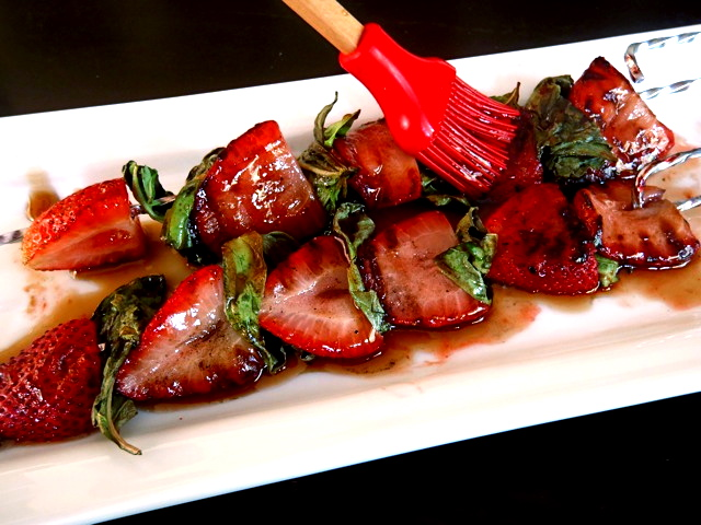 Grilled Strawberry Basil Kebabs with Honey Balsamic Glaze on a bright white platter.