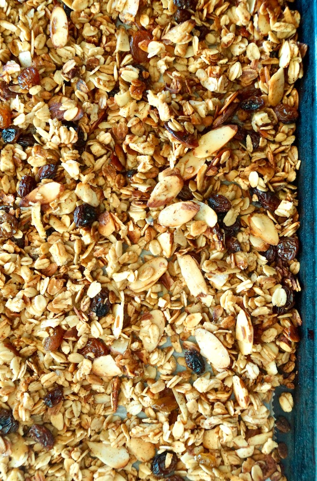 Sheet pan with an even layer of golden roasted pumpkin spice apple granola.