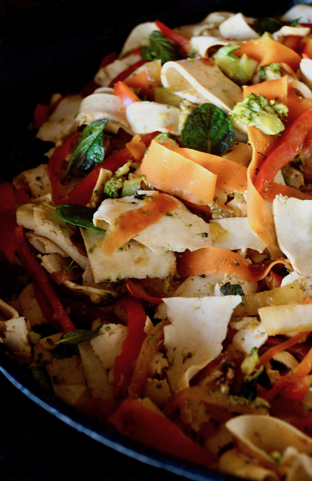 Vegetarian Mint Stir Fry Recipe wtih Tofu Noodles in a black saute pan.