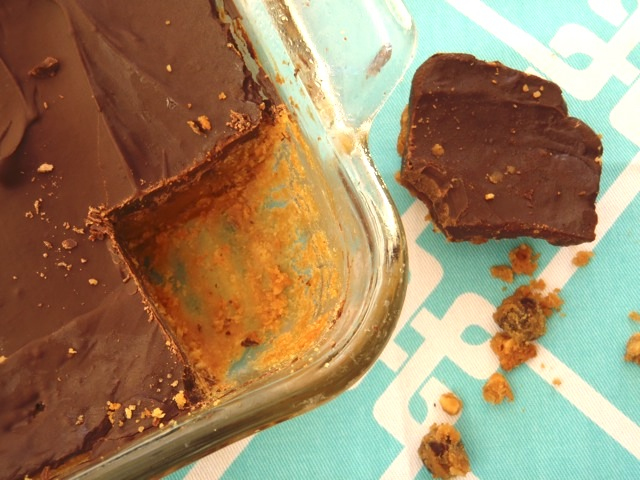 Chocolate Peanut Butter Fudge in a baking dish with the corner piece cut out