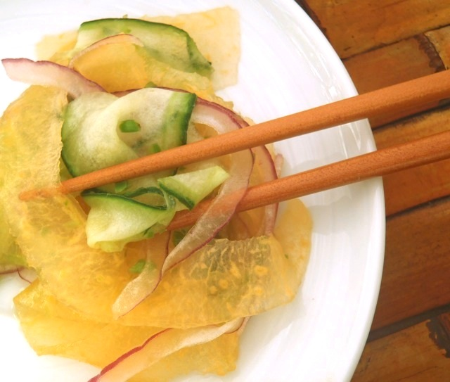 Cucumber Melon Salad Recipe with Yuzu Dressing on a white plate with chopsticks