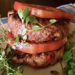 grilled mediterranean burger recipe - 2 burgers and 2 tomato slices stcked