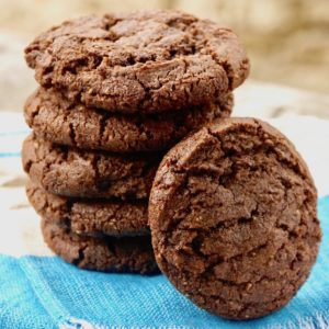 Stack of Double Chocolate Almond Spice Cookies with one resting on it
