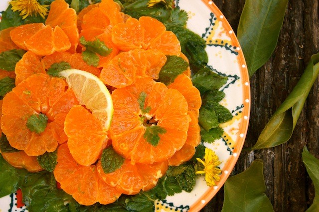 orange-rimmed plate with satsuma slices.