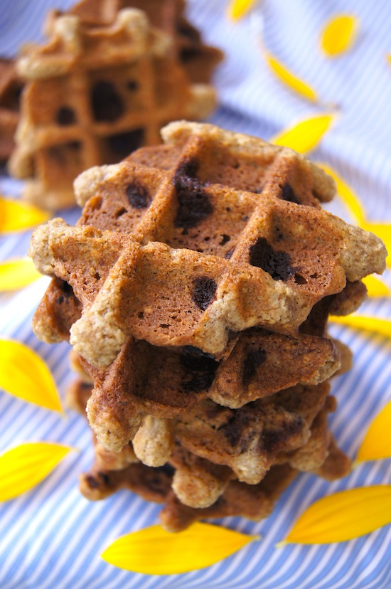 Waffle Chocolate Chip Cookies on a light blue cloth with yellow flower petals