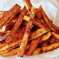pile of Smoky Chipotle French Fries on Parchment