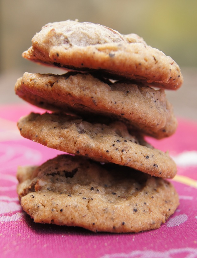 a stack of four Café Con Leche Chocolate Chunk Cookies on a magenta cloth
