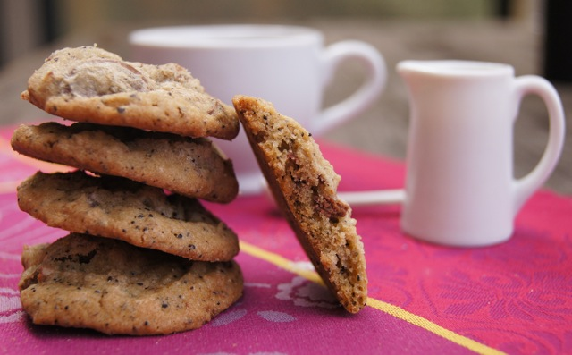 stack of four Café Con Leche Chocolate Chunk Cookies with a half a cookie on its side, leaning agains them