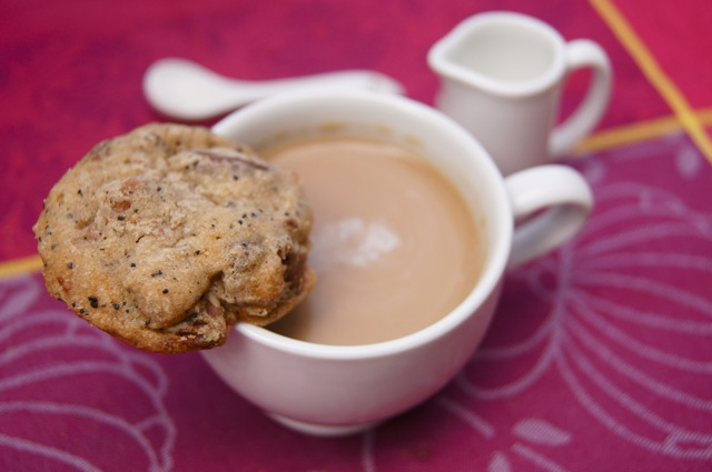one of the Café Con Leche Chocolate Chip Cookies resting on a coffe mug rim