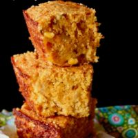 stack of 3 square cornbread pieces with title text at top