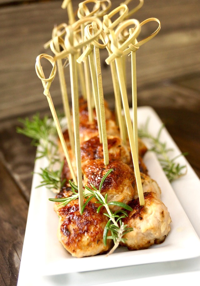 rosemary turkey meatballs on white plate with toothpicks
