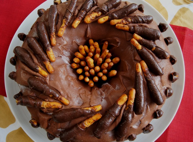 Top view of a whole Chocolate Peanut Butter Pretzel Ice-Cream Cake on white platter.