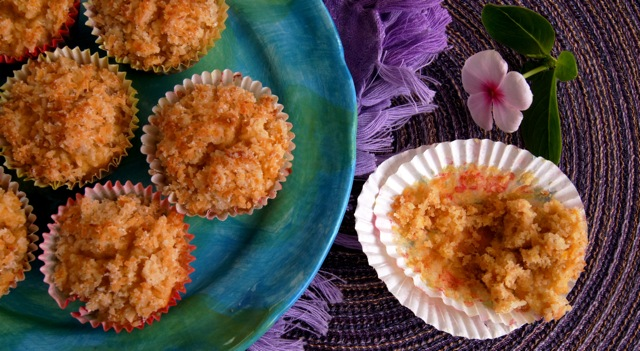 Gluten-Free Lemon Coconut Muffins on a blue-green plate.