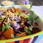Rainbow stirped bowl with Roasted Butternut Squash Vegetarian Chili