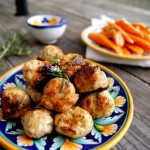 Small plate with meatballs with carrots in background