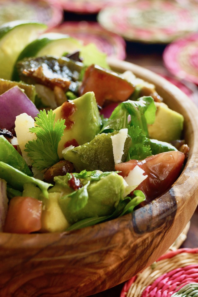 Chopped Mexican Salad with Pepitas in a wooden bowl