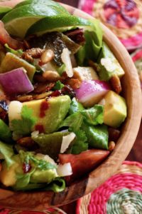 Top view of Chopped Mexican Salad with Pepitas in a wooden bowl