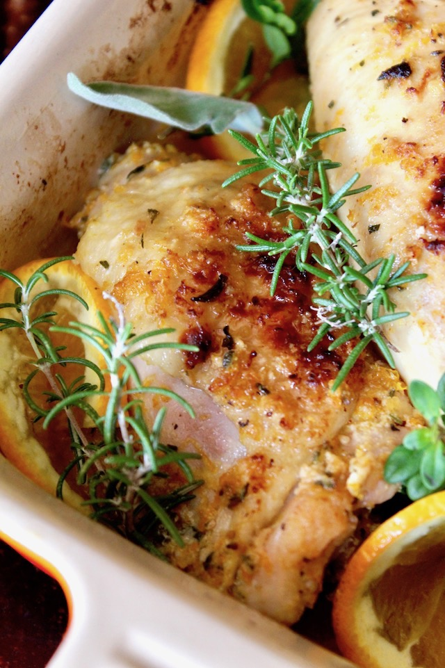 whole cut up chicken, skin on and roasted with orange slices and fresh herbs