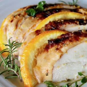 sliced chicken with crispy skin and orange slices