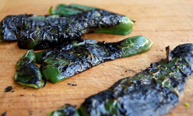 roasted poblanos on a cutting board