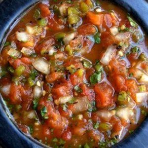 roasted tomato poblano salsa in black bowl