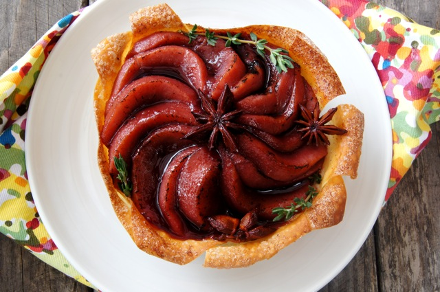 Port Wine Poached Pear slices fanned out on a tart shell