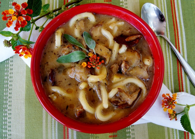 Sweet Potato Sausage Soup with Udon Noodles in a bright red bowl