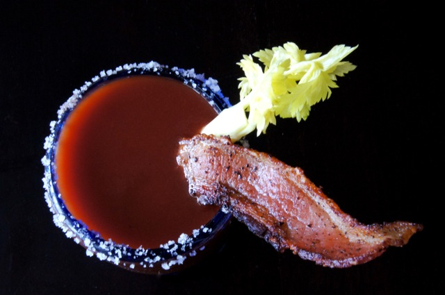 Top view of a Bloody Mary with a bacon and celery stick.