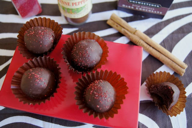 Spicy Mayan Chocolate Truffles on a flat red plate