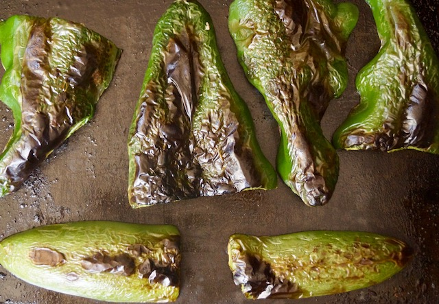 roasted poblano and jalapeno chilies on sheet pan
