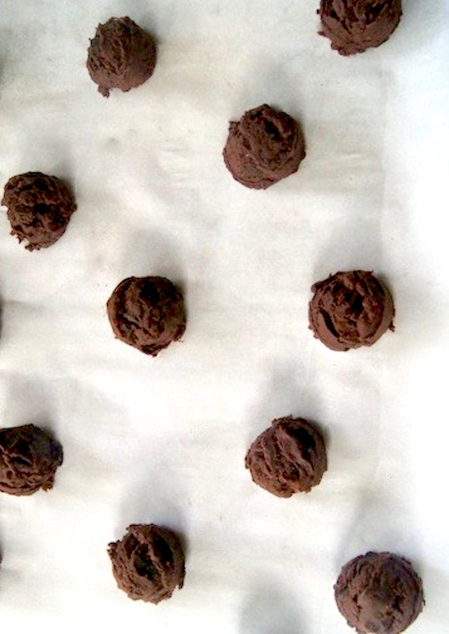 Gluten-Free Nutella Chocolate Chip cookie dough formed into balls on parchment paper