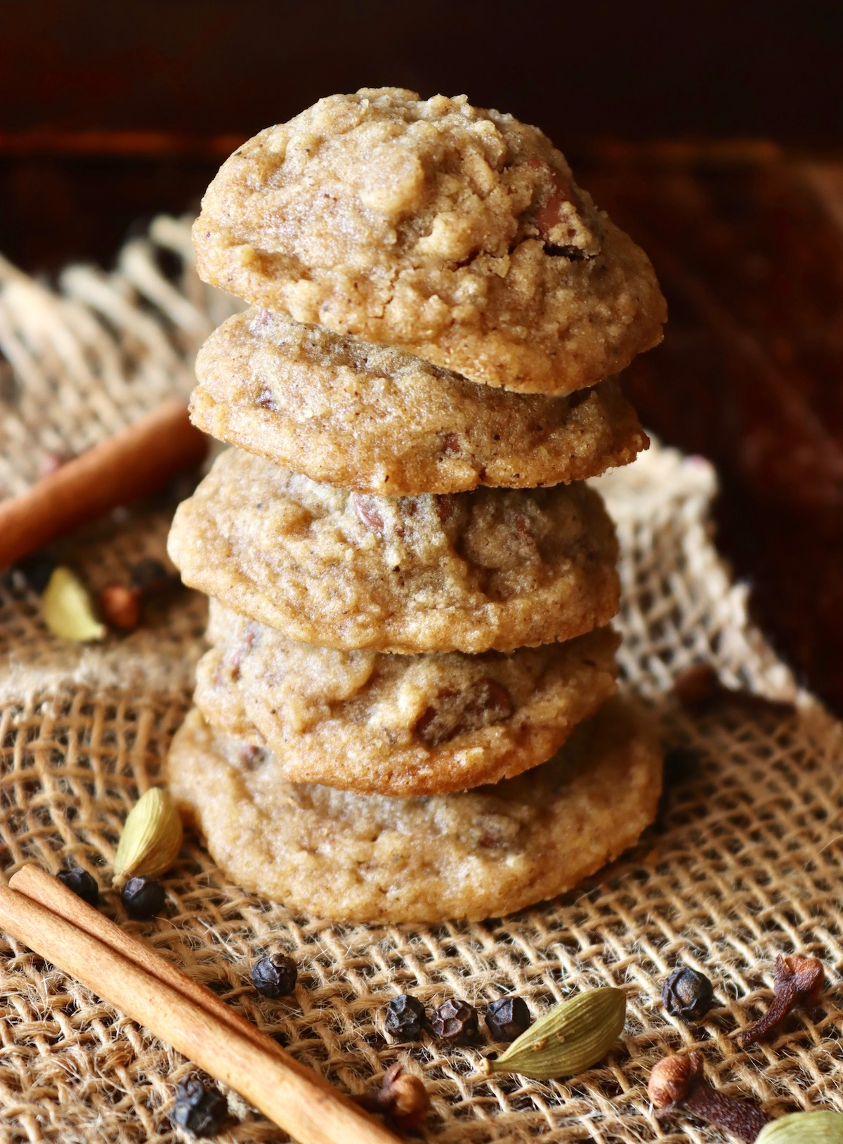 Stack of 5 Chocolate Chai Cookies with a cinnamon stick.