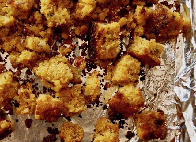 toasted cornbread cubes on baking sheet