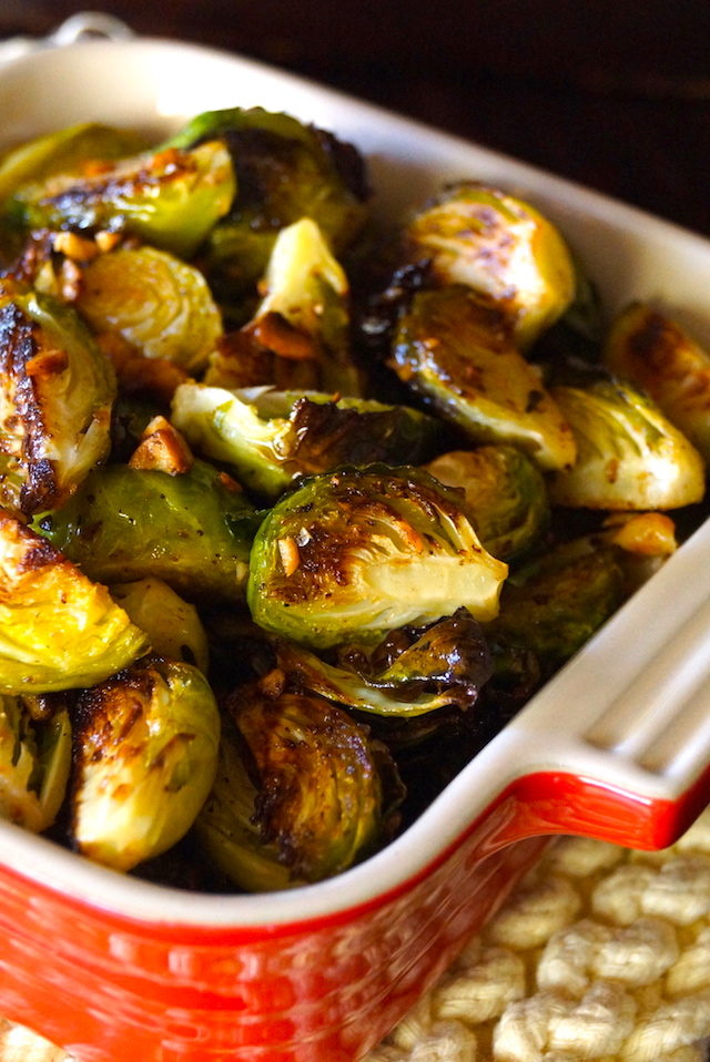 Roasted Brown Butter Hazelnut Brussels Sprouts in small red casserole dish