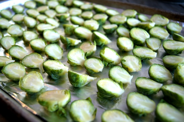 raw brussels sprouts halved on a sheet pan