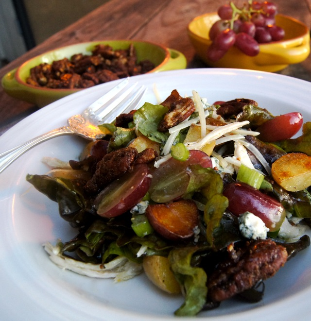 salad with grapes and Sweet Spiced Caramelized Pecans on a white plate