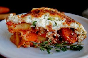 slice of root vegetable lasagna on white plate