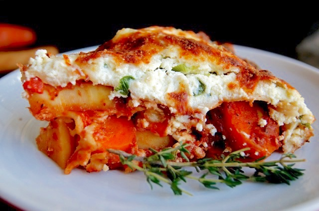 Root Vegetable Lasagna on white plate with fresh thyme