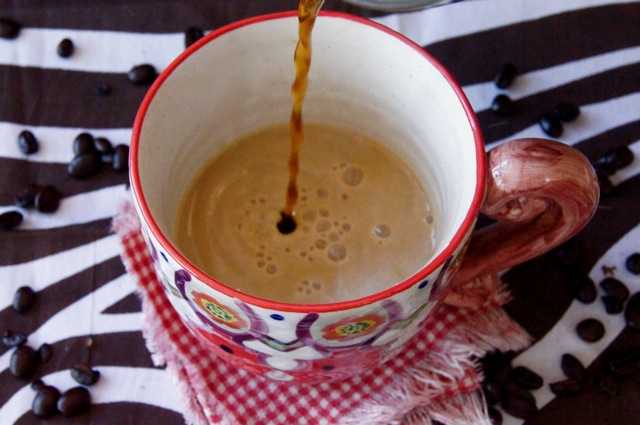 This is how to make coffee with half and half -- coffee being poured into the half and half