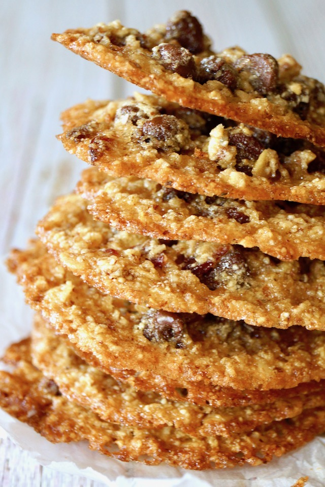 Tall stack of Oatmeal Lace Cookies with white background.