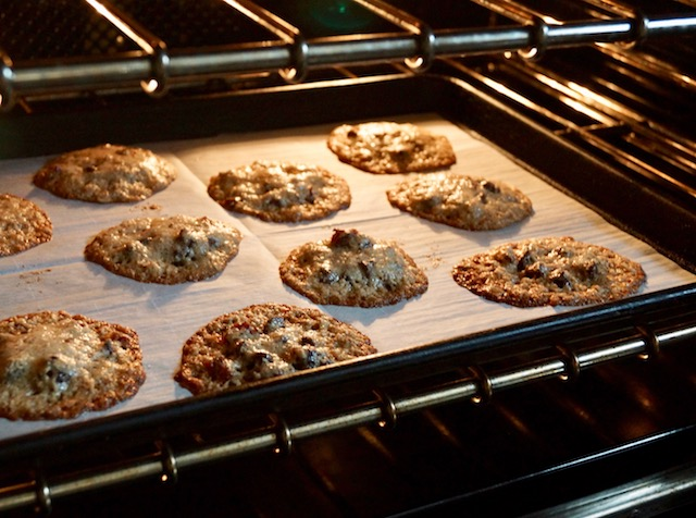 oatmeal lace cookies in the oven on sheet pan