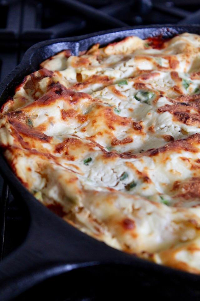 baked lasagna in cast iron skillet